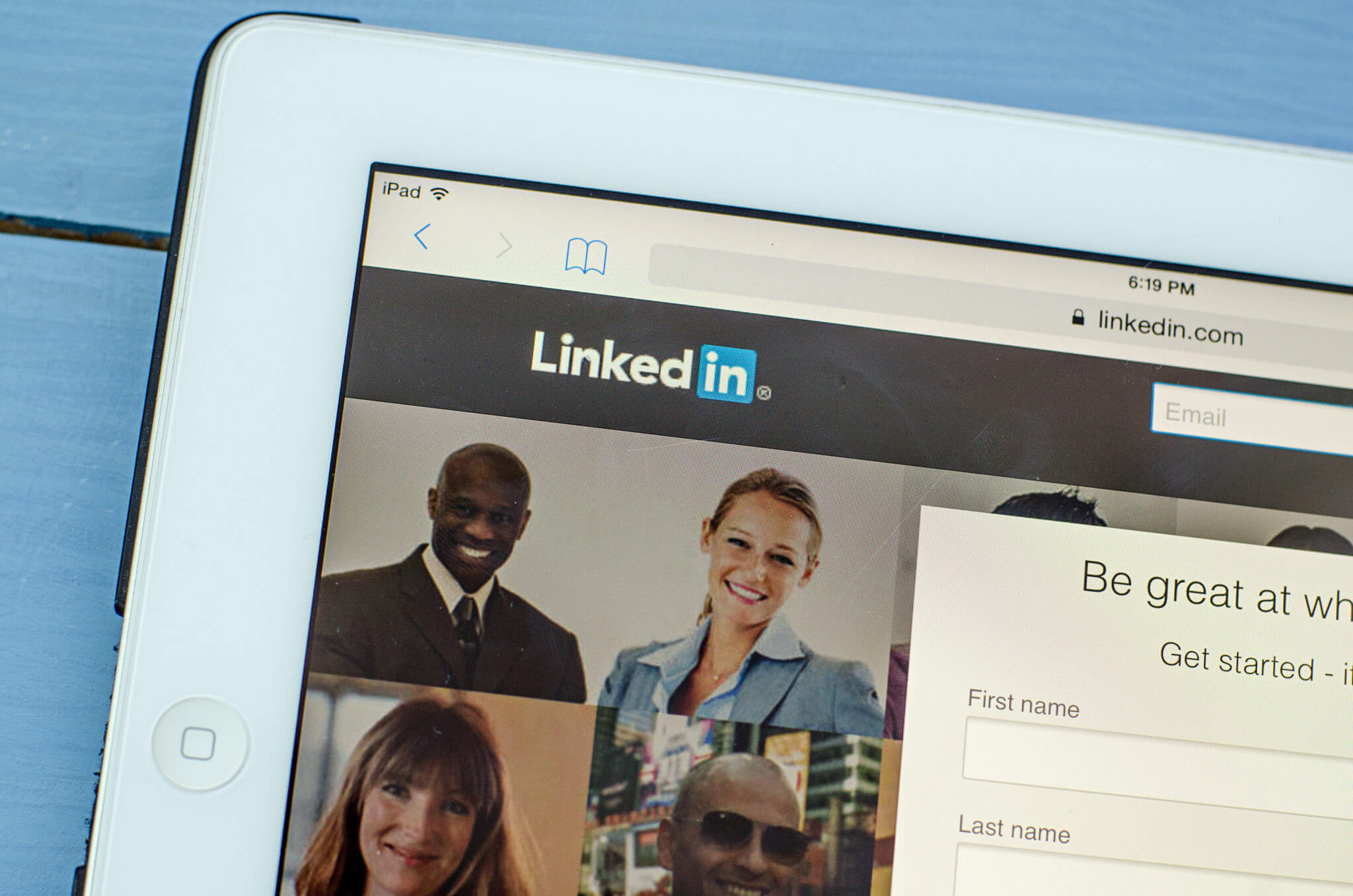 A white tablet displays the LinkedIn.com home page; time for a LinkedIn profile makeover.