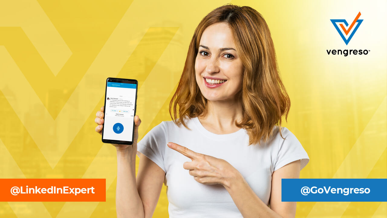 Girl pointing at phone with LinkedIn Voice Messaging app opened
