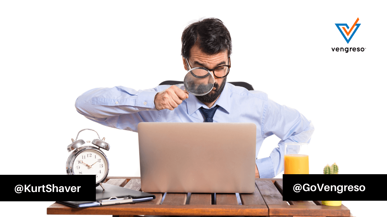 businessman his office with magnifying glass looking for warm leads online
